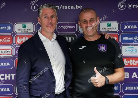 RSCA Anderlecht's sports director Michael Verschueren (L)  and RSCA Anderlecht's new coach Simon Davies react during a press conference at Constant Vanden Stock Stadium in Brussels, Belgium, 17 June 2019.
