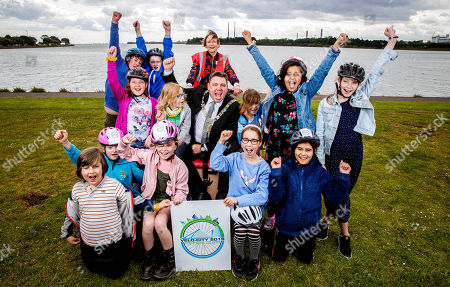 """Pictured here are The new Lord Mayor, Paul McAuliffe, pupils from Springdale National School, Edenmore, Dublin 5 and Clara Clark (Cycling without Age) at the launch of the Velo-city 2019 Bike Parade, which takes place on 26th June and is now open to the public to register and take part. They were also joined by the new Lord Mayor, Paul Mc Auliffe and Dublin City Council Chief Executive Owen Keegan. The Bike Parade is just one of the exciting activities happening in the city to celebrate the world's largest cycling conference, Velo-city 2019 """"Cycling for the Ages"""", which is taking place in the Convention Centre from 25th ñ 28th June 2019. Cycling enthusiasts, school children and families who wish to take part in the Bike Parade with the conference delegates can join the route at the Sails Sculpture which is located in Clontarf at 3:30pm on 26th June."""