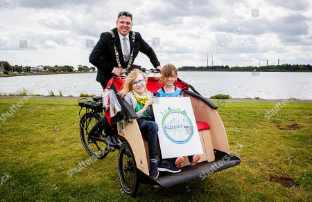 """Pictured here are Lord Mayor Paul McAuliffe with Robert Poynton and Evie Spencer at the launch of the Velo-city 2019 Bike Parade, which takes place on 26th June and is now open to the public to register and take part. They were also joined by the new Lord Mayor, Paul Mc Auliffe and Dublin City Council Chief Executive Owen Keegan. The Bike Parade is just one of the exciting activities happening in the city to celebrate the world's largest cycling conference, Velo-city 2019 """"Cycling for the Ages"""", which is taking place in the Convention Centre from 25th ñ 28th June 2019. Cycling enthusiasts, school children and families who wish to take part in the Bike Parade with the conference delegates can join the route at the Sails Sculpture which is located in Clontarf at 3:30pm on 26th June."""