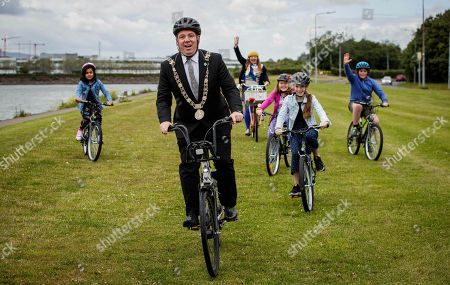 """Stock Picture of Pictured here are pupils from Springdale National School, Edenmore, Dublin 5, cyclists from Cycling without Age and the new Lord Mayor, Paul McAuliffe at the launch of the Velo-city 2019 Bike Parade, which takes place on 26th June and is now open to the public to register and take part. They were also joined by the new Lord Mayor, Paul Mc Auliffe and Dublin City Council Chief Executive Owen Keegan. The Bike Parade is just one of the exciting activities happening in the city to celebrate the world's largest cycling conference, Velo-city 2019 """"Cycling for the Ages"""", which is taking place in the Convention Centre from 25th ñ 28th June 2019. Cycling enthusiasts, school children and families who wish to take part in the Bike Parade with the conference delegates can join the route at the Sails Sculpture which is located in Clontarf at 3:30pm on 26th June."""