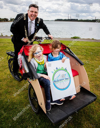 """Stock Image of Pictured here are Lord Mayor Paul McAuliffe with Robert Poynton and Evie Spencer at the launch of the Velo-city 2019 Bike Parade, which takes place on 26th June and is now open to the public to register and take part. They were also joined by the new Lord Mayor, Paul Mc Auliffe and Dublin City Council Chief Executive Owen Keegan. The Bike Parade is just one of the exciting activities happening in the city to celebrate the world's largest cycling conference, Velo-city 2019 """"Cycling for the Ages"""", which is taking place in the Convention Centre from 25th ñ 28th June 2019. Cycling enthusiasts, school children and families who wish to take part in the Bike Parade with the conference delegates can join the route at the Sails Sculpture which is located in Clontarf at 3:30pm on 26th June."""