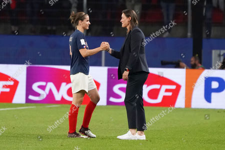 Corinne Diacre (2-L), head coach of France celebrates with Charlotte Bilbault of France after the FIFA Women's World Cup 2019 Group A soccer match between Nigeria and France in Rennes, France, 17 June 2019.