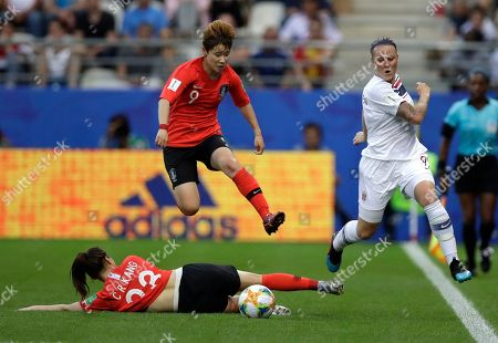 Stock Photo of Norway's Isabell Herlovsen, right, kicks the ball clear of South Korea's Moon Mi-ra, and Kang Chae-rim, bottom, during the Women's World Cup Group A soccer match between Norway and South Korea at the Stade Auguste-Delaune in Reims, France