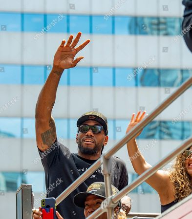 Toronto Raptors forward Kawhi Leonard celebrates aboard an open bus during a victory parade through downtown Toronto, Canada, 17 June 2019. The 2019 NBA Champion Toronto Raptors defeated the Golden State Warriors to win their first NBA basketball championship.