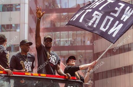 Toronto Raptors guard Jodie Meeks (L) and forward Serge Ibaka (C) celebrate aboard an open bus during a victory parade through downtown Toronto, Canada, 17 June 2019. The 2019 NBA Champion Toronto Raptors defeated the Golden State Warriors to win their first NBA basketball championship.