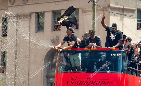 Toronto Raptors guard Malcolm Miller (L), guard Jodie Meeks (C) and forward Serge Ibaka (R) celebrate aboard an open bus during a victory parade through downtown Toronto, Canada, 17 June 2019. The 2019 NBA Champion Toronto Raptors defeated the Golden State Warriors to win their first NBA basketball championship.
