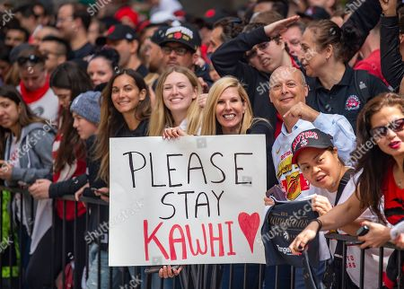 Toronto Raptors fans wait for the start of a victory parade honoring the Toronto Raptors in downtown Toronto, Canada, 17 June 2019. The 2019 NBA Champion Toronto Raptors defeated the Golden State Warriors to win their first NBA basketball championship. Many fans held signs urging Raptors forward forward Kawhi Leonard to stay with the Raptors.