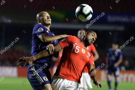Japan's Daizen Maeda, left, and Chile's Jean Beausejour battle for the ball during a Copa America Group C soccer match at the Morumbi stadium in Sao Paulo, Brazil