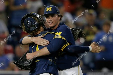 Tommy Henry, Joe Donovan. Michigan pitcher Tommy Henry, right, is hugged by catcher Joe Donovan after pitching a complete game against Florida State in an NCAA College World Series baseball game in Omaha, Neb