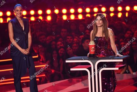 "Sandra Bullock, Gal Gadot. Sandra Bullock accepts the award for most frightened performance for ""Bird Box"" as presenter Gal Gadox looks on at the MTV Movie and TV Awards, at the Barker Hangar in Santa Monica, Calif"