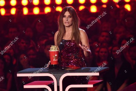 """Sandra Bullock accepts the award for most frightened performance for """"Bird Box"""" at the MTV Movie and TV Awards, at the Barker Hangar in Santa Monica, Calif"""
