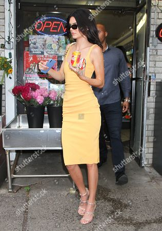 Kendall Jenner stops to buy a Orange Vanilla Coke and Nutella Breadsticks in Manhattan