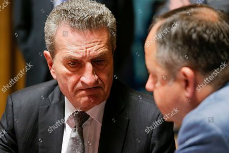 EU Budget Commissioner, German Guenther Oettinger (L) chats with Polish European Affairs Minister Konrad Szymanski (R) at the start of the General Affairs Council (GAC) in Luxembourg, 18 June 2019. The council will hold a policy debate on the next multiannual financial framework (MFF) and ministers will prepare for the European Council meeting scheduled for 20-21 June 2019.