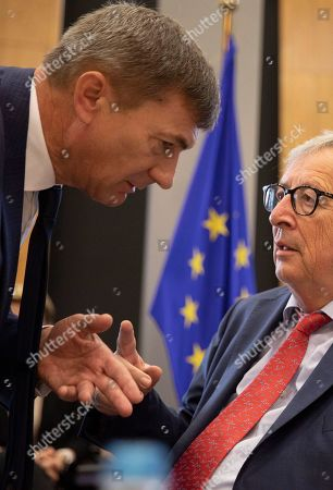 European Commission President Jean-Claude Juncker, right, speaks with European Commissioner for Digital Single Market Andrus Ansip during a weekly meeting of EU commissioners at EU headquarters in Brussels