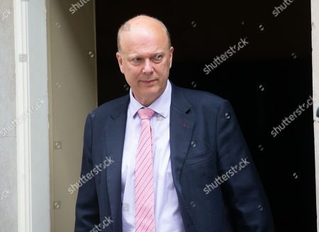 Chris Grayling, Secretary of State for Transport, arrives for the weekly Cabinet meeting.