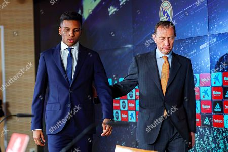 Real Madrid's new Brazilian forward Rodrygo Goes (L) arrives for a press conference with the club's institutional relations director Emilio Butragueno (R) during his presentation as new player of the Spanish La Liga soccer club at Santiago Bernabeu Stadium in Madrid, Spain, 18 June 2019. Rodrygo joins Real Madrid from Brazilian side FC Santos for a reported transfer fee of about 45 million euro.