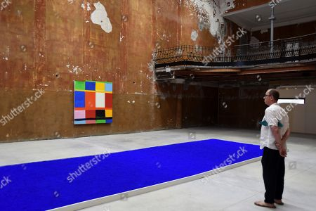 A visitor looks at a work on display by US artist Stanley Whitney during the opening the exhibition 'Stanley Whitney / Yves Klein: This Array of Colors' at the Cayon Gallery in Mahon, Mallorca island, Spain, 18 June 2019. The event will be open to public until 05 September 2019. EFE/ David Arquimbau Sintes