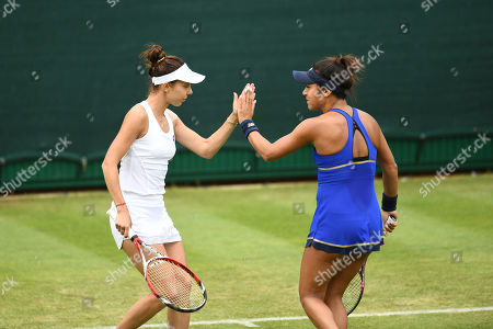Heather Watson of Great Britain and Mihaela Buzarnescu of Romania during their 1st round doubles match against Raquel Atawo of the USA and Lyudmyla Kichenok of the Ukraine.
