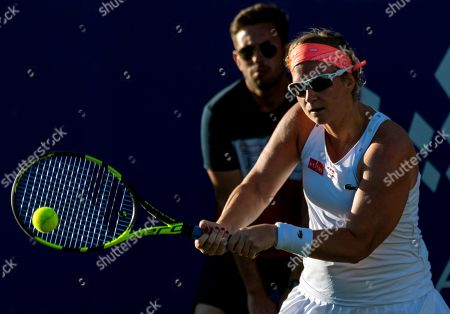 Ysaline Bonaventure of Belgium in action against Angelique Kerber of Germany during their WTA Mallorca Open round 32 match at Santa Ponsa's Club in Mallorca, Balearic Islands, Spain, 18 June 2019.