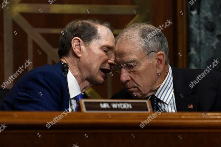 Stock Image of Ron Wyden, Chuck Grassley. Senate Finance Committee ranking member Sen. Ron Wyden, D-Ore., left, talks with committee chairman Sen. Chuck Grassley, R-Iowa, right, during a hearing with United States Trade Representative Robert Lighthizer on Capitol Hill in Washington, on 'The President's 2019 Trade Policy Agenda and the United States-Mexico-Canada Agreement