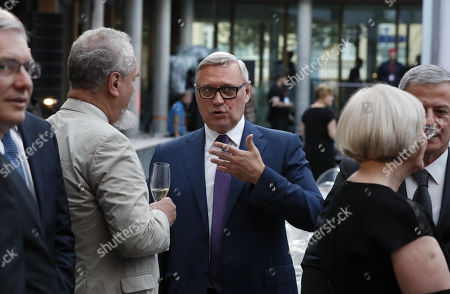 Former Russian Prime Minister Mikhail Kasyanov (C) attends the opening ceremony of the new Swiss embassy building in Moscow, Russia, 18 June 2019. The new building is a major undertaking, combining extensive renovation and new construction of Switzerland's official representation in Russia.