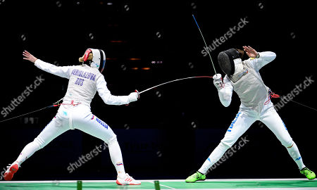Inna Deriglazova of Russia (L) in action against Elisa Di Francisca of Italy (R) during the foil women's individual final of the 2019 Fencing European Championships in Duesseldorf, Germany, 18 June 2019.