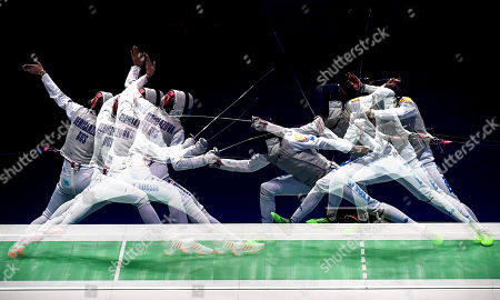 A multiple exposure picture showing Inna Deriglazova of Russia (L) in action against Elisa Di Francisca of Italy (R) during the foil women's individual final of the 2019 Fencing European Championships in Duesseldorf, Germany, 18 June 2019.