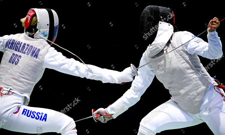 Inna Deriglazova of Russia (L) in action against Alice Volpi of Italy (R) during the foil women's individual semi final of the 2019 Fencing European Championships in Duesseldorf, Germany, 18 June 2019.