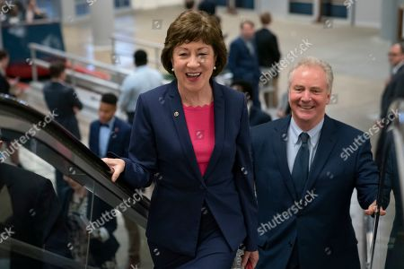 Republican Sen. Susan Collins of Maine, joined by Sen. Tim Kaine, D-Va., right, arrives at the Capitol to extend her perfect Senate voting record to 7,000, as she prepares for a 2020 campaign, in Washington