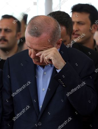 Turkish President Recep Tayyip Erdogan reacts as he attends funeral prayers in absentia for ousted former Egyptian President Mohammed Morsi, at Fatih Mosque in Istanbul, . Funeral prayers were held in mosques across Turkey for Morsi, who had close ties to Erdogan. The former president, who was ousted by current President Abdel-Fattah el-Sissi in a military coup in 2013, collapsed in a courtroom in Egypt during trial on Monday and died