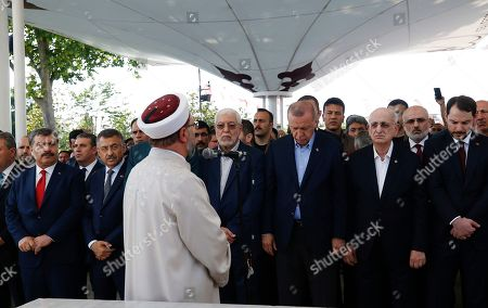 Turkish President Recep Tayyip Erdogan, center right, attends funeral prayers in absentia for ousted former Egyptian President Mohammed Morsi, at Fatih Mosque in Istanbul, . Funeral prayers were held in mosques across Turkey for Morsi, who had close ties to Erdogan. The former president, who was ousted by current President Abdel-Fattah el-Sissi in a military coup in 2013, collapsed in a courtroom in Egypt during trial on Monday and died