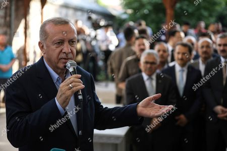 Turkish President Recep Tayyip Erdogan speaks after attending funeral prayers in absentia for ousted former Egyptian President Mohammed Morsi, at Fatih Mosque in Istanbul, . Funeral prayers were held in mosques across Turkey for Morsi, who had close ties to Erdogan. The former president, who was ousted by current President Abdel-Fattah el-Sissi in a military coup in 2013, collapsed in a courtroom in Egypt during trial on Monday and died