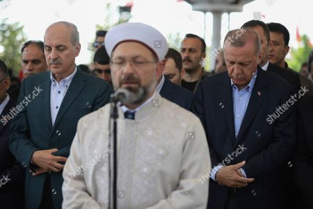 Turkish President Recep Tayyip Erdogan, right, attends funeral prayers in absentia for ousted former Egyptian President Mohammed Morsi, at Fatih Mosque in Istanbul, . Funeral prayers were held in mosques across Turkey for Morsi, who had close ties to Erdogan. The former president, who was ousted by current President Abdel-Fattah el-Sissi in a military coup in 2013, collapsed in a courtroom in Egypt during trial on Monday and died