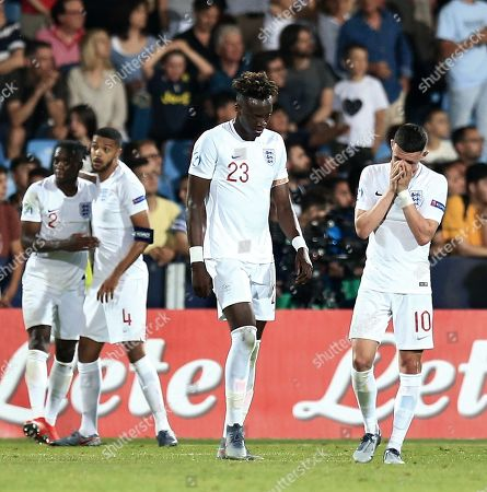 Phil Foden of England and Tammy Abraham of England dejected after France 2nd goal