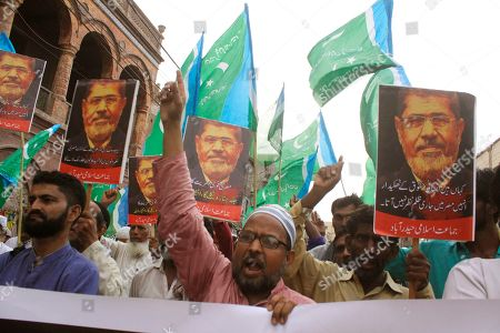 Supporters of the Pakistani religious party Jamaat-i-Islami, chant slogans for ousted former Egyptian President Mohammed Morsi in Hyderabad, Pakistan. . Morsi, Egypt's first democratically elected president ousted by the military in 2013, collapsed during a trial session in Cairo on Monday and died