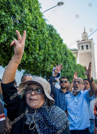 People chant slogans for ousted former Egyptian President Mohammed Morsi in Tunis, Tunisia. . The former president, who was ousted by current President Abdel-Fattah el-Sissi in a military coup in 2013, collapsed in a courtroom in Egypt during trial on Monday and died