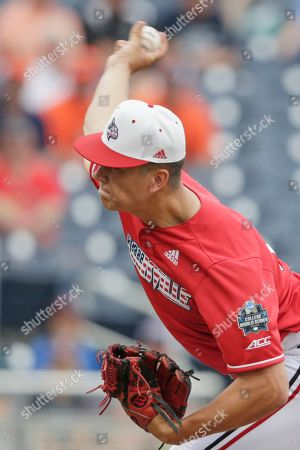 Louisville starting pitcher Bobby Miller delivers against Auburn in the first inning of an NCAA College World Series baseball game in Omaha, Neb