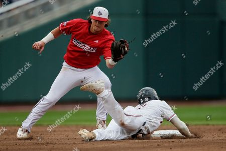Stock Picture of Will Holland, Tyler Fitzgerald. Auburn's Will Holland, right, steals second base against Louisville shortstop Tyler Fitzgerald in the third inning of an NCAA College World Series baseball game in Omaha, Neb