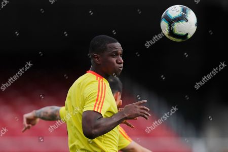 Colombia's Cristian Zapata heads the ball during a training session of the national soccer team in Sao Paulo, Brazil, . Colombia will face Qatar on Wednesday in a Group B match of the Copa America soccer tournament