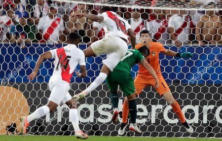 Peru's Jefferson Farfan (10) heads the ball to score against Bolivia during the second half of a Copa America Group B soccer match at Maracana stadium in Rio de Janeiro, Brazil