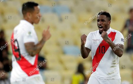 Peru's Jefferson Farfan, right, celebrates scoring his side's second goal against Bolivia during a Copa America Group B soccer match at Maracana stadium in Rio de Janeiro, Brazil