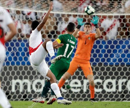 Peru's Jefferson Farfan, left, makes an attempt on goal as Bolivia's goalkeeper Carlos Lampe stops the ball during a Copa America Group B soccer match at Maracana stadium in Rio de Janeiro, Brazil