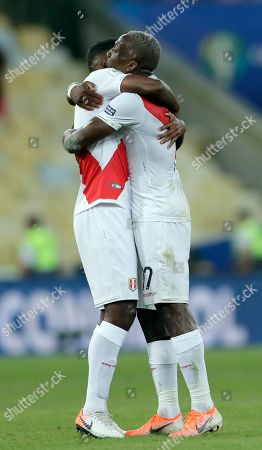 Peru's Miguel Araujo, left, and Peru's Luis Advincula embrace as they celebrate their 3-1victory over Boliva in a Copa America Group B soccer match at Maracana stadium in Rio de Janeiro, Brazil