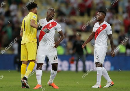Peru's goalkeeper Pedro Gallese, left, Luis Advincula, center, and Miguel Araujo meet in the center of the pitch to celebrate their 3-1 victory over Bolivia during a Copa America Group B soccer match at Maracana stadium in Rio de Janeiro, Brazil