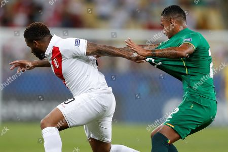Peru's Jefferson Farfan (L) vies for the ball against Adrian Jusino (R) of Bolivia during the Copa America 2019 Group A soccer match between Bolivia and Peru, at Maracana Stadium in Rio de Janeiro, Brazil, 18 June 2019.