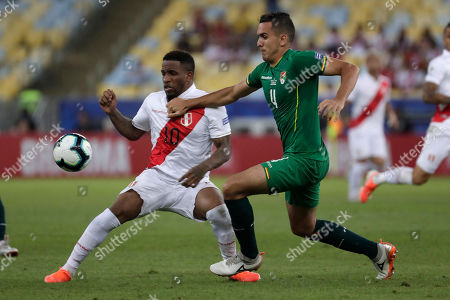 Bolivia's Luis Haquin, right, and Peru's Jefferson Farfan compete for the ball during a Copa America Group A soccer match at the Maracana stadium in Rio de Janeiro, Brazil