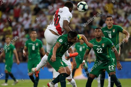 Peru's Jefferson Farfan, top, scores against Bolivia during a Copa America Group A soccer match at the Maracana stadium in Rio de Janeiro, Brazil