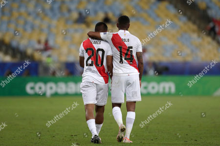 Peru's Edison Flores, left, is congratulated by Andy Polo after scoring his side's 3rd goal against Bolivia during a Copa America Group A soccer match at the Maracana stadium in Rio de Janeiro, Brazil