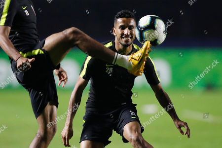 Qatar's Ahmed Fathi eyes the ball during a training session in Sao Paulo, Brazil, . Qatar will face Colombia on Wednesday for a Group B match of the Copa America soccer tournament