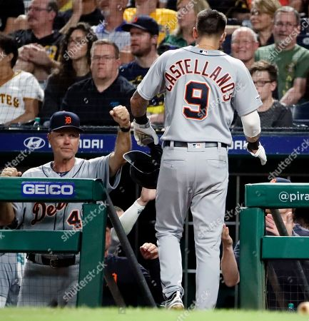 Steve Liddle, Nicholas Castellanos. Detroit Tigers' Nicholas Castellanos (9) is greeted by bench coach Steve Liddle, left, after scoring on a ground out by Brandon Dixon off Pittsburgh Pirates relief pitcher Kyle Crick during the eighth inning of a baseball game in Pittsburgh, . The Tigers won 5-4